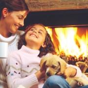 mother daughter and dog enjoying warmth